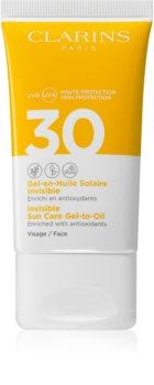 Clarins Invisible Sun Care Gel-to-Oil opalovací fluid na obličej SPF 30