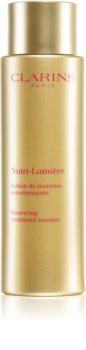 Clarins Nutri-Lumière Renewing Treatment Essence crema nutritiva împotriva îmbătrânirii pielii