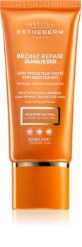 Institut Esthederm Bronz Repair Sunkissed Protective Anti-Wrinkle And Firming Tinted Face Care tonujący krem ochronny przeciw zmarszczkom