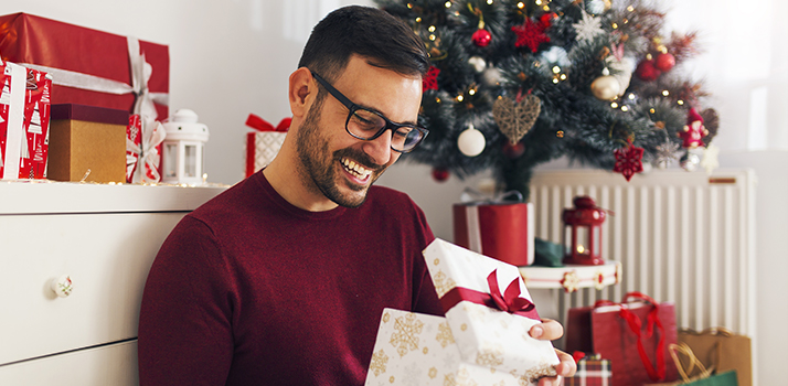 man opens a gift