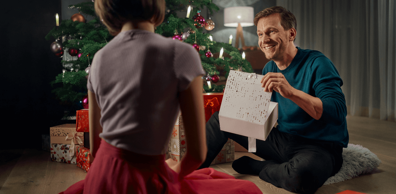 a man opening a christmas gift