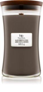 Woodwick Black Amber & Citrus candela profumata grande