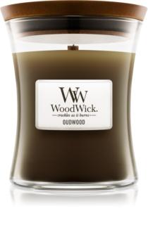 Woodwick Oudwood dišeča sveča  z lesenim stenjem
